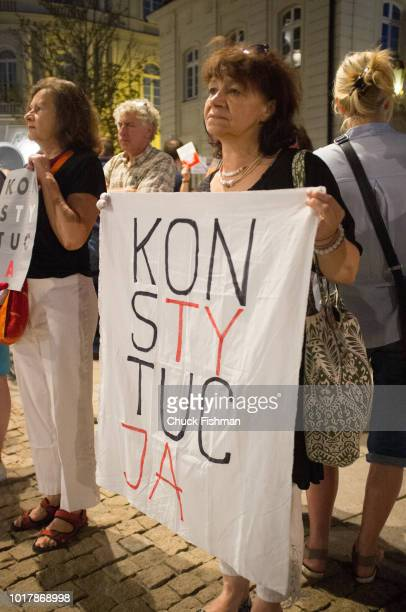 Antigovernment protesters gather in front of the presidential palace to rally against a string of judicial reforms that the European Union has dubbed...