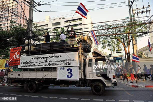 Antigovernment protesters gather outside a polling station to disrupt voting in Thailand's general election on February 2 2014 in Bangkok Thailand...