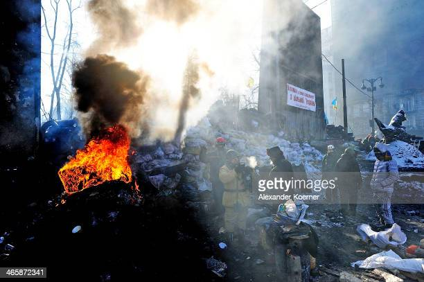 Antigovernment Protesters gathered at a barricade during sunrise on Hrushevskoho Street on January 30 2014 in Kiev Ukraine Ukraine's Prime Minister...