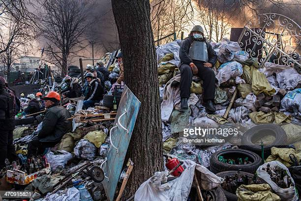 Antigovernment protesters guard barricades near Independence Square on February 21 2014 in Kiev Ukraine Ukraine's president Viktor Yanukovych is...