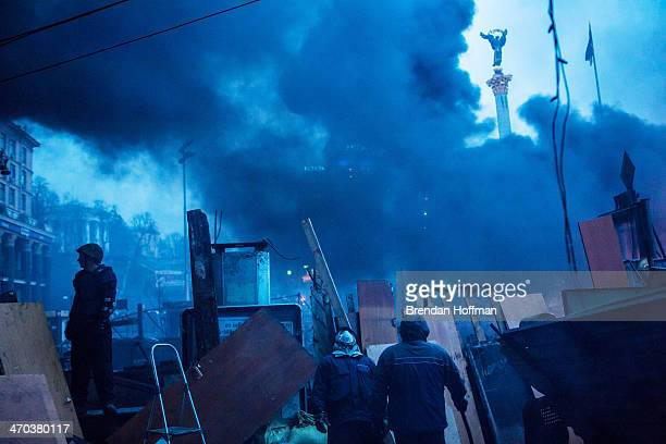 Antigovernment protesters guard the barricades on Independence Square on February 19 2014 in Kiev Ukraine After several weeks of calm violence has...