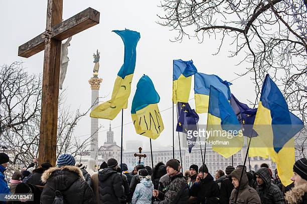 Antigovernment protesters hold a religious service on a hill overlooking Independence Square on December 13 2013 in Kiev Ukraine Thousands of people...