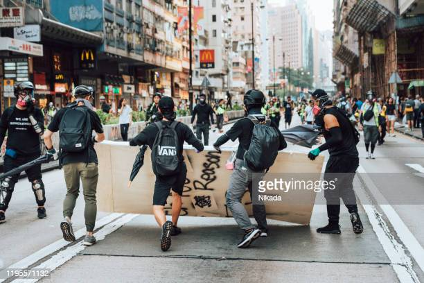 anti-government protesters in hongkong - riot stock pictures, royalty-free photos & images