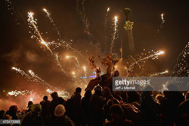 Antigovernment protesters let off fireworks during demonstrations in Independence Square on February 19 2014 in Kiev Ukraine After several weeks of...