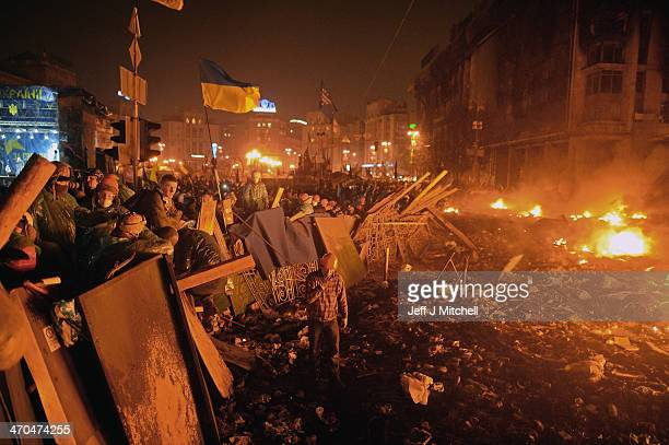 Antigovernment protesters man barricades during demonstrations in Independence Square on February 19 2014 in Kiev Ukraine After several weeks of calm...