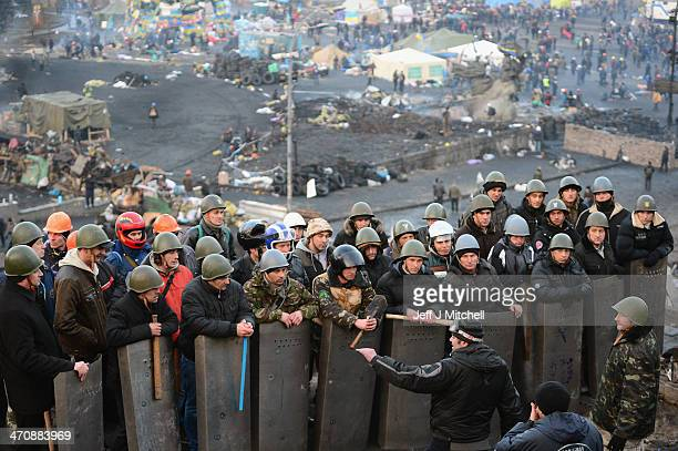 Antigovernment protesters man the front line barricades following yesterdays clashes with police in Independence square on February 21 2014 in Kiev...