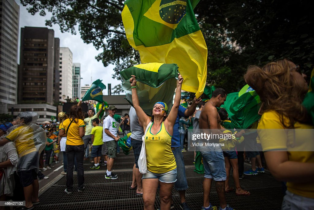 Anti-government protesters march along Avenida Paulista on March 15, 2015 in Sao Paulo, Brazil. Protests across the country were held today against President Dilma Rousseff's government with many protesters calling for her impeachment. A massive corruption scandal at Brazil's state-owned oil company Petrobras has rocked the government and Dilma's approval ratings are now around 23 percent.