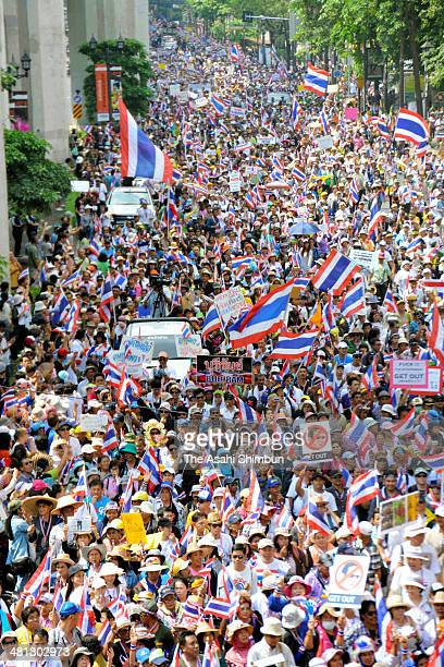 Antigovernment protesters march through the city centre on March 29 2014 in Bangkok Thailand Tens of thousands of antigovernment protesters marched...
