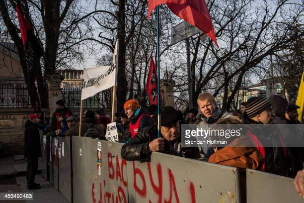 Antigovernment protesters monitor a barricade near the Presidential Administration building on December 4 2013 in Kiev Ukraine Thousands of people...