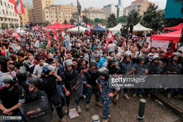 Antigovernment protesters rally on the eighth day of protest against tax increases and official corruption at Riad alSolh square in the capital...