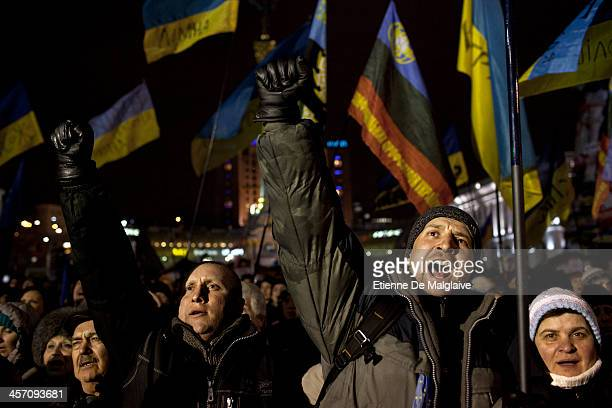 Antigovernment protesters react to a speech from opposition leader Vitali Klitschko in Independance Square on December 16 2013 Thousands of people...