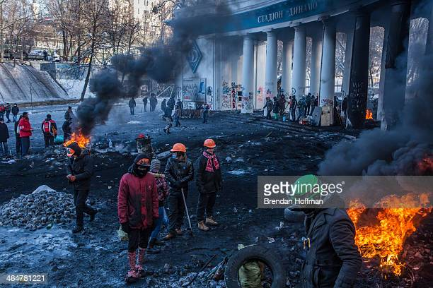 Antigovernment protesters set fire to tyres near Dynamo Stadium on January 24 2014 in Kiev Ukraine After two months of primarily peaceful...