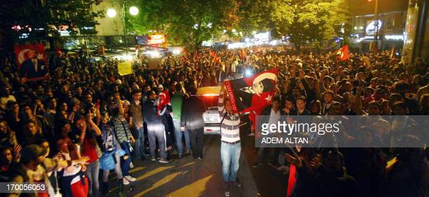Antigovernment protesters shout slogans and wave Turkish national flags during a demonstration in central Ankara June 6 2013 against the...