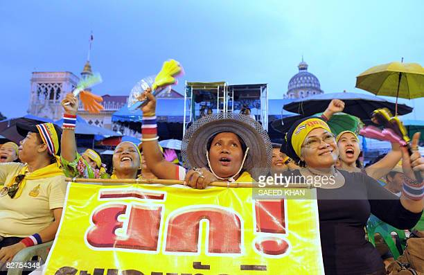 Anti-government protesters shout slogans while listening to speeches at an ongoing demonstration inside Government House in Bangkok, September 10,...