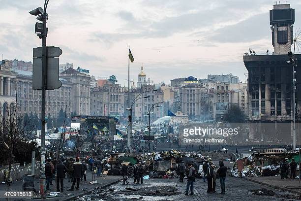 Antigovernment protesters stand around in Independence Square on February 21 2014 in Kiev Ukraine Ukraine's president Viktor Yanukovych is thought to...