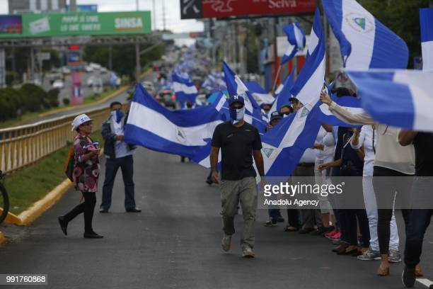 Antigovernment protesters stand forming a Human Chain during a protest against Nicaraguan President Daniel Ortega's government in Managua Nicaragua...