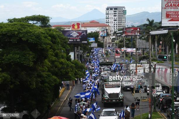 Antigovernment protesters stand forming a Human Chain in Managua on July 4 2018 Thousands of Nicaraguans stood Wednesday forming a Human Chain in the...