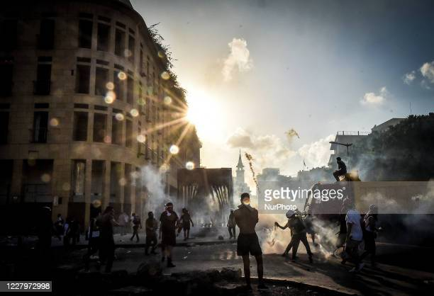 Anti-government protesters take part in a demonstration against the political elites and the government, in Beirut, Lebanon, on August 8, 2020 after...