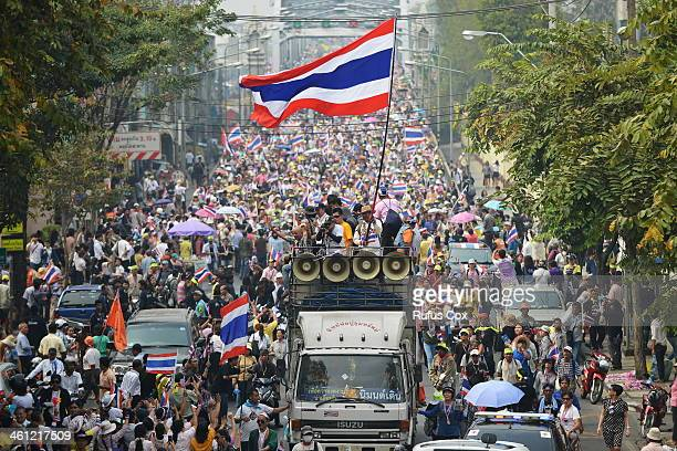 Anti-government protesters take part in a large march organised by the People's Democratic Reform Committee on January 7, 2014 in Bangkok, Thailand....