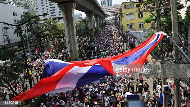 Antigovernment protesters take part in a large march through the city centre on March 29 2014 in Bangkok Thailand Tens of thousands of antigovernment...