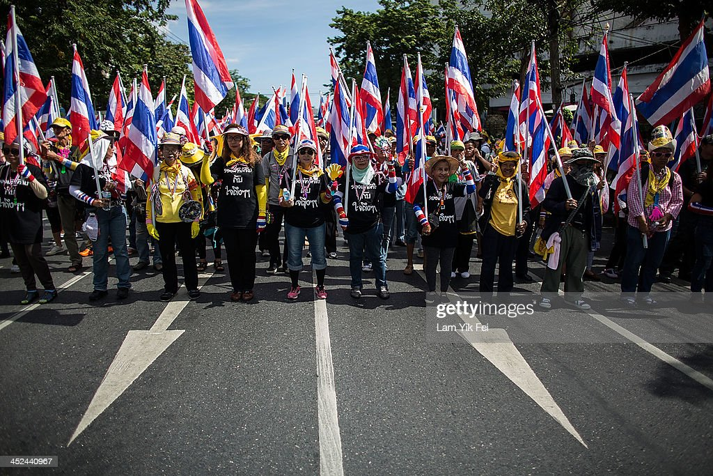 Anti-government protesters take part in a march at parliament on November 29, 2013 in Bangkok, Thailand. Anti-government protesters in Bangkok say they plan to march towards the headquarters of Prime Minister Yingluck Shinawatra's ruling party today, as they continue their campaign to overthrow her.