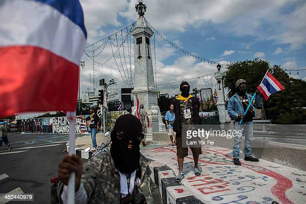 Antigovernment protesters take part in a march at parliament on November 29 2013 in Bangkok Thailand Antigovernment protesters in Bangkok say they...