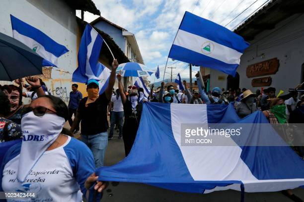 Antigovernment protesters take part in a march dubbed United Nicaragua will never be defeated in Granada Nicaragua on August 25 2018 Thousands...