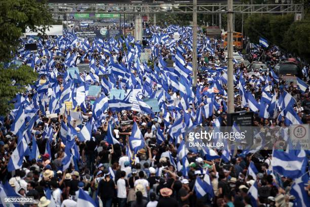 Antigovernment protesters take part in a march in support of the Mothers of April movement whose children died in the protests on Nicaragua's...