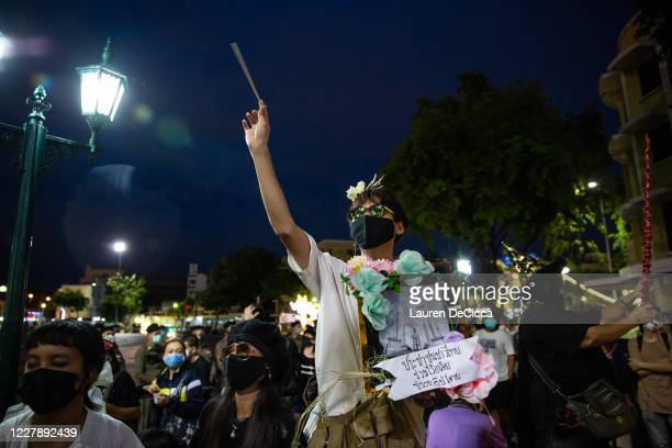 Antigovernment protesters wave chopsticks as makeshift wands while they take part in a Harry Potter themed rally in front of Democracy Monument on...