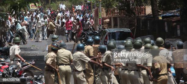 Antigovernment protestor pelting stones on Policeman in Ratnagiri city during the bandh call by Shiv Sena to protest against proposed Jaitapur...