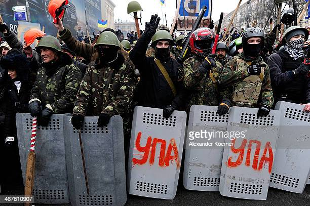 Antigovernment protestors are pictured moving up Khreshchatyk Street just outside of Independence Square on February 8 2014 in Kiev Ukraine Opponents...