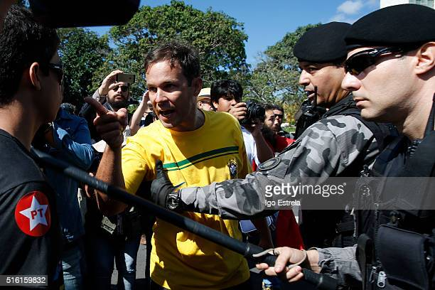 Antigovernment protestors clash with police as they demonstrate before Brazil's former president Luiz Inacio Lula da Silva was sworn in as the new...