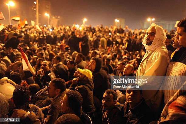 Antigovernment protestors continue to defy the curfew as they wait to hear President Hosni Mubarak speak on television in Tahrir Square on February 1...
