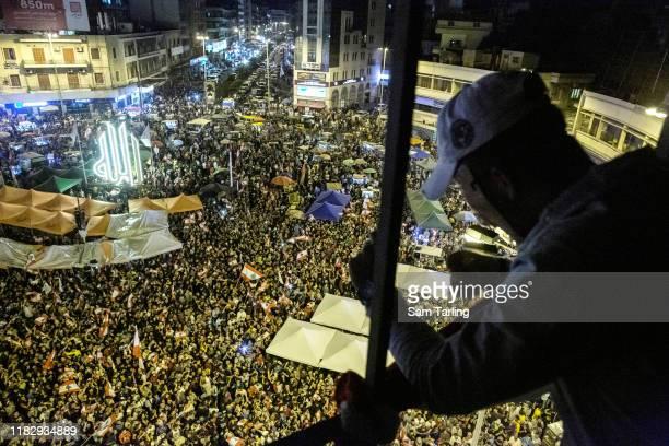 Antigovernment protestors gather in Nour Square on October 23 2019 in Tripoli Lebanon For the 7th consecutive day demonstrators are still in the...