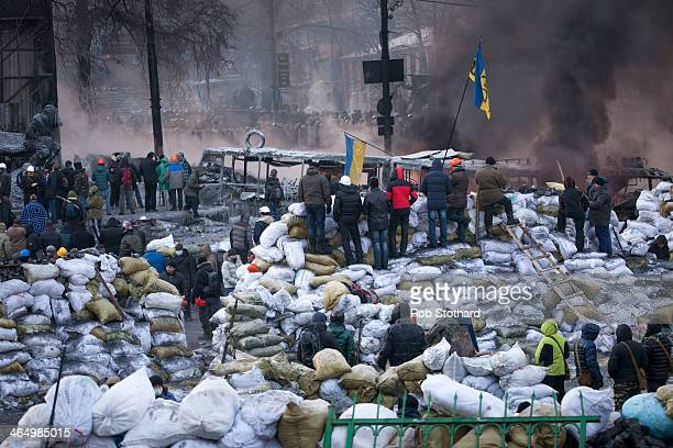 Antigovernment protestors gather near Dynamo Stadium on January 25 2014 in Kiev Ukraine Violent protests in Ukraine have spread beyond the capital as...