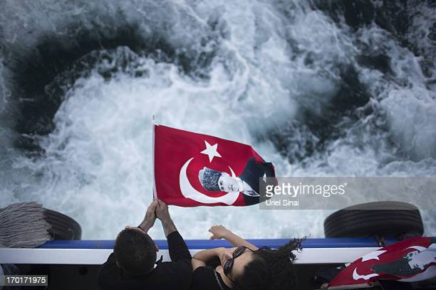 Antigovernment protestors ride a ferry boat from the Asian to the European side of Istanbul in order to get to Taksim Square on June 8 2013 in...