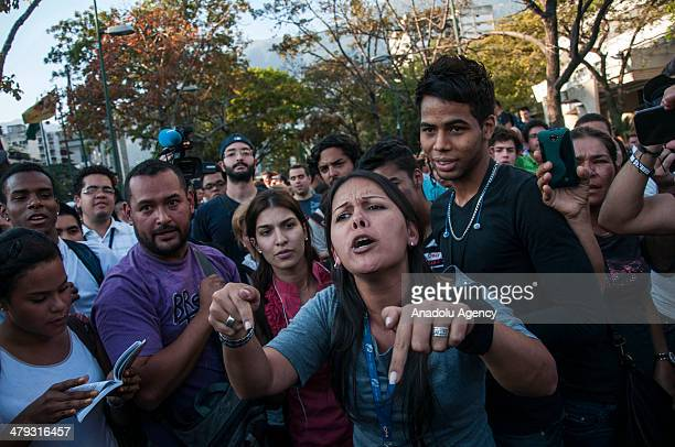Antigovernment protestors shout slogans at the Altamira square in Caracas Venezuuela on March 17 2014 Soldiers in Caracas stormed and cleared an...