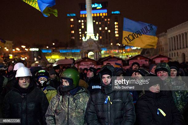 Antigovernment protestors stand in front of a stage in Independence Square on January 28 2014 in Kiev Ukraine Ukraine's President Viktor Yanukovych...