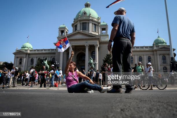 Anti-government protestors stand in front of the parliament building ahead of the inaugural parliament session in Belgrade, on August 3, 2020. - The...