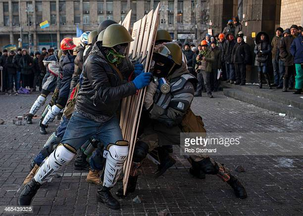 Antigovernment protestors take part in a training exercise in Independence Square on January 27 2013 in Kiev Ukraine Unrest is spreading across...