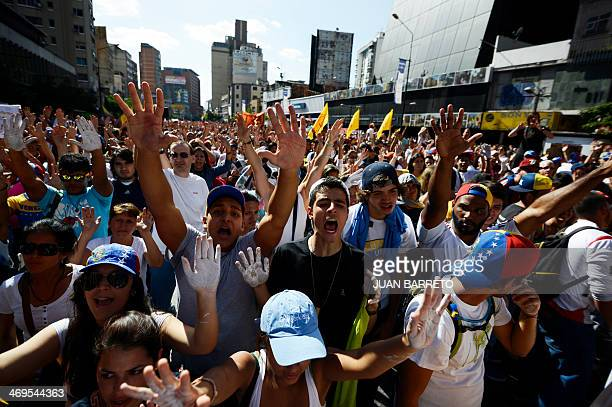 Antigovernment students shout slognas during a protest in front of the Venezuelan Judiciary building in Caracas on February 15 2014 Opposition and...