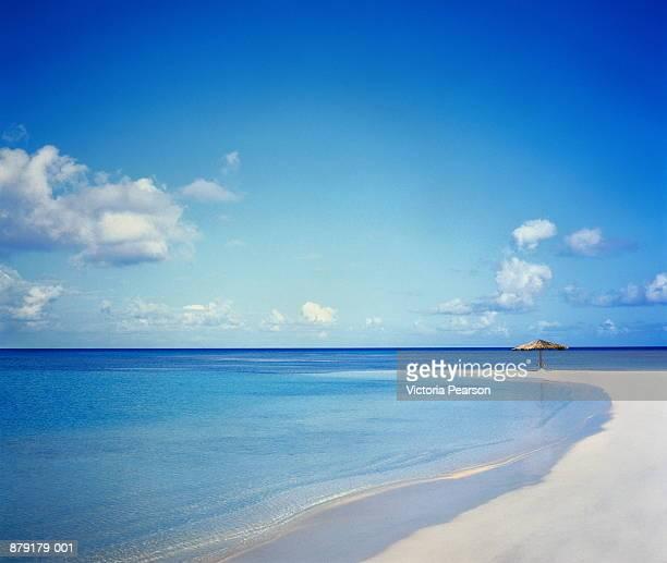 Antigua, Jumby Bay, umbrella on beach