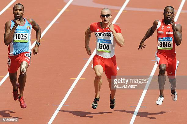 Antigua's Brendan Christian Canada's Jared Connaughton and Trinidad and Tobago's Aaron Armstrong compete during the men's first round 200m race at...