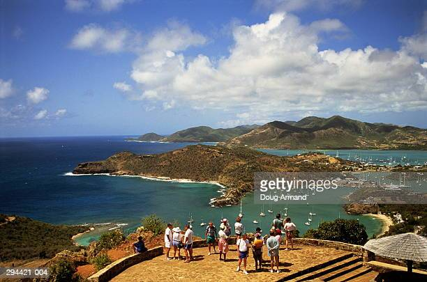 antigua,shirley heights,tourists overlooking english harbour - antigua & barbuda stock pictures, royalty-free photos & images