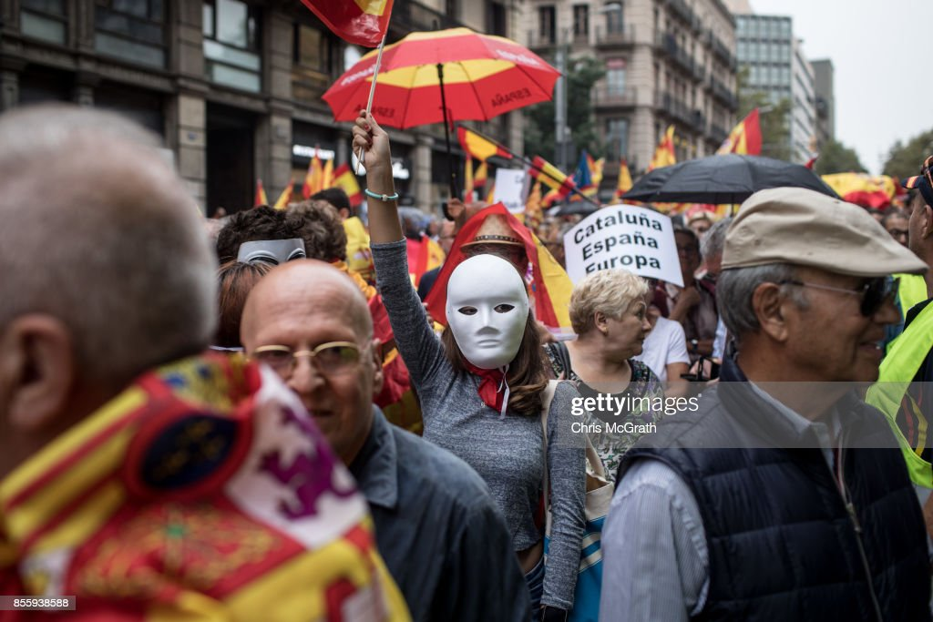 Anti-independence demonstrators march in protest against the independence referendum on September 30, 2017 in Barcelona, Spain. The Catalan government is keeping with its plan to hold a referendum, due to take place on October 1, which has been deemed illegal by the Spanish government in Madrid.