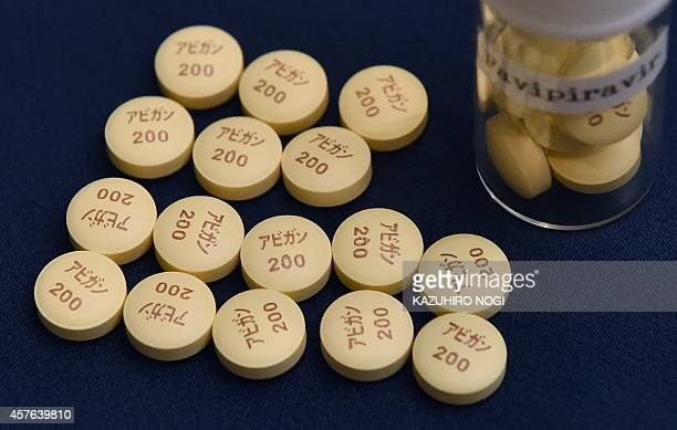 Antiinfluenza Avigan Tablets produced by Japan's Fujifilm are displayed in Tokyo on October 22 2014 Fujifilm said late on October 20 it would...