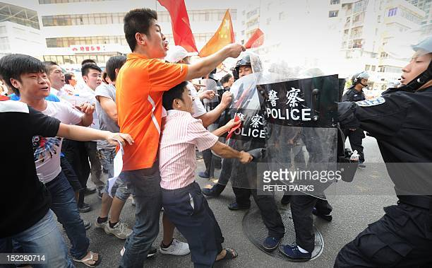 AntiJapan protesters clash with riot police in the southern Chinese city of Shenzhen on September 18 2012 Thousands of antiJapan protesters rallied...