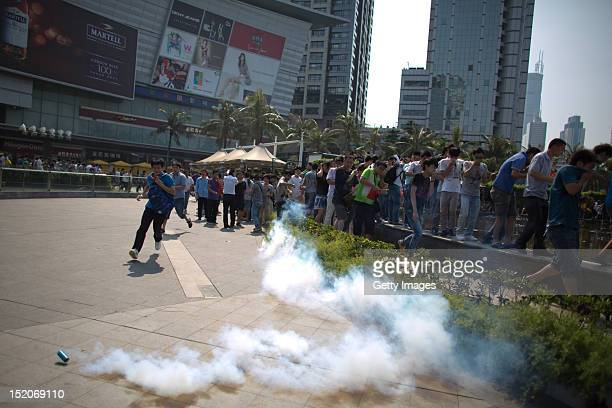 AntiJapanese protesters flee from tear gas as they demonstrate over the disputed Diaoyu Islands on September 16 2012 in Shenzhen China Protests have...