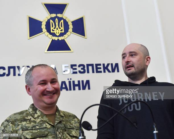 AntiKremlin Russian journalist Arkady Babchenko and the head of Ukraine's security service Vasyl Grytsak react during a press conference at the...