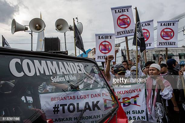 AntiLGBT activists protest on February 23 2016 in Yogyakarta Indonesia Indonesia ministers and religious leaders have taken additional steps to...